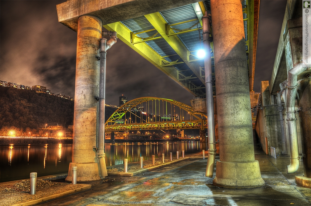 Fort Pitt Bridge framed by the pillars of the Mon Wharf reflected into the night-time waters of the Monongahela River, Pittsburgh PA, January 12, 2012, Photo by Glen Green